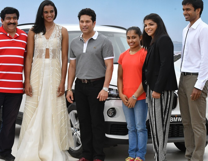 Cricket legend Sachin Tendulkar presented Rio Olympics silver medallist PV Sindhu and bronze winner Sakshi Malik along with gymnast Dipa Karmakar and badminton coach Pullela Gopichand. The car was sponsored by Hyderabad Badminton Association president Chamundeshwarnath (left)