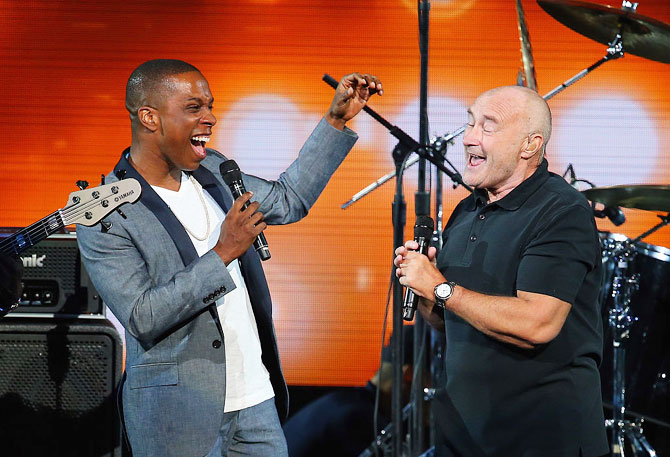 British singer Phil Collins (right) and American actor and singer Leslie Odom, Jr. perform 'Easy Lover' during opening ceremony on Day 1 of the 2016 US Open on Monday