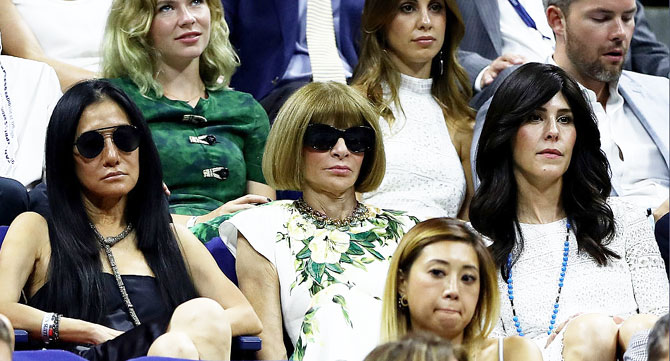 Editor of 'Vogue' magazine Anna Wintour watches the first round match between Novak Djokovic and Jerzy Janowicz
