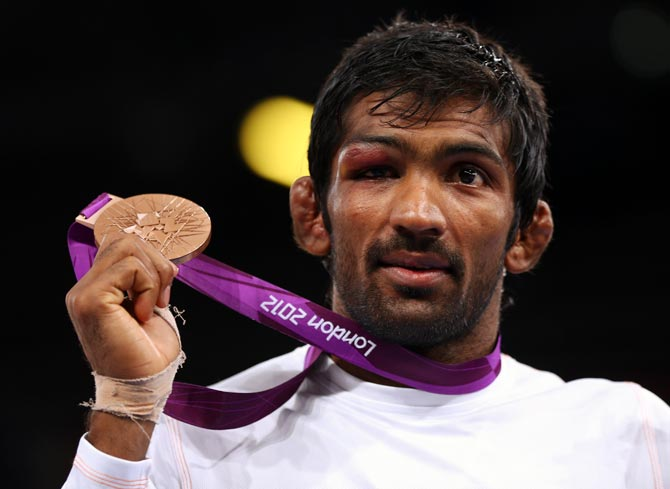 Yogeshwar Dutt poses with his bronze medal in the men's Freestyle 60 kg Wrestling at the London 2012 Olympic Games, on August 11, 2012