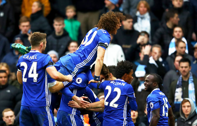 Chelsea players including David Luiz (top) celebrate their team's third goal during their Premier League match against Manchester City