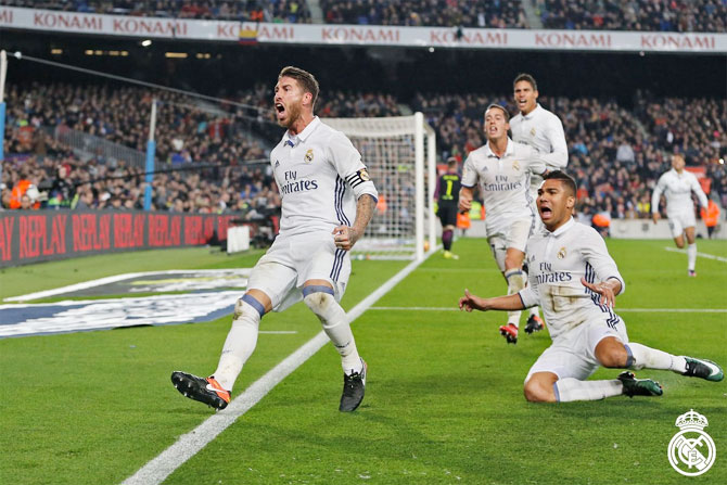 Real Madrid's Sergio is ecstatic after heading in the equaliser against FC Barcelona during their El Clasico La Liga match at the Camp Nou on Saturday