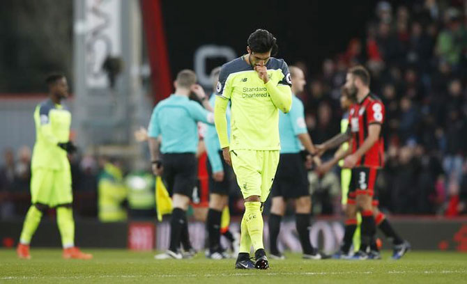 Liverpool's Emre Can is a dejected figure after the game against Bournemouth
