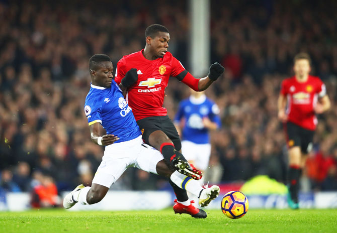 Manchester United's Paul Pogba (right) is challenged by Everton's Idrissa Gueye during their Premier League match at Goodison Park in Liverpool, on Sunday