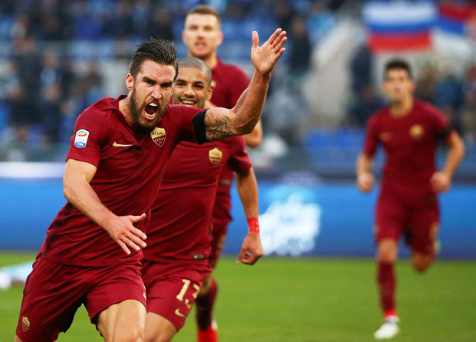 AS Roma's Kevin Strootman (left) celebrates after scoring