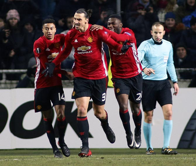 Rediff Sports - Cricket, Indian hockey, Tennis, Football, Chess, Golf - PHOTOS: Mkhitaryan sparkles as United reach Europa last 32