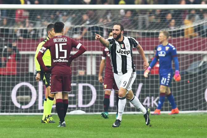 Juventus FC's Gonzalo Higuain (right) celebrates a goal during the Serie A match against FC Torino at Stadio Olimpico di Torino in Turin on Sunday