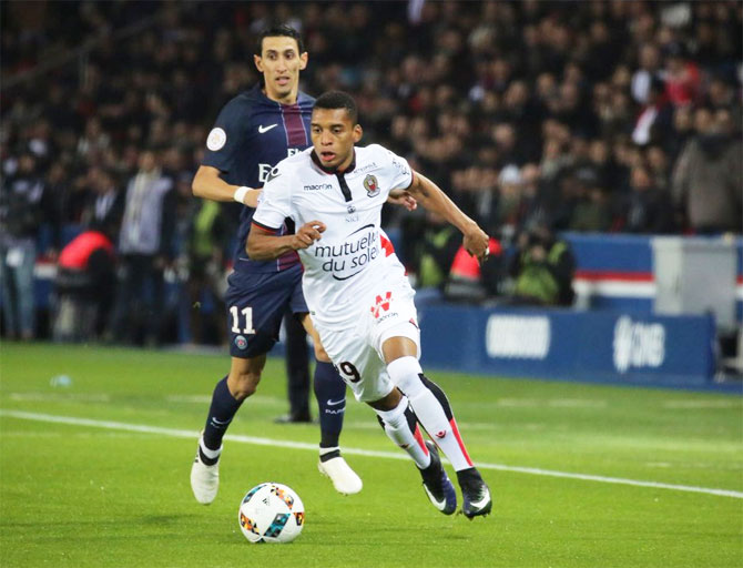 OGC Nice FC's Dalbert Henrique runs with the ball past PSG's Angel di Maria during their Ligue 1 match on Sunday