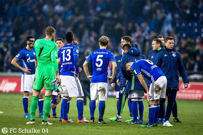 Players of Schalke 04 wear a dejected look after their Bundesliga match against Bayer Leverkusen on Sunday