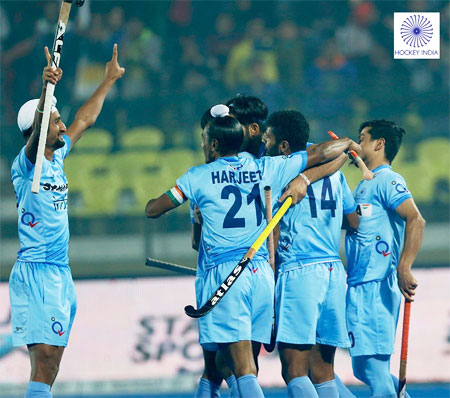 India Junior hockey team players celebrate a goal against Spain in Lucknow on Thursday