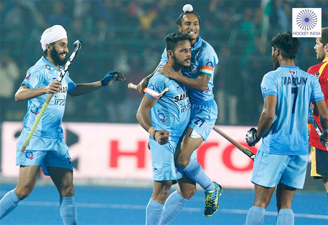 India's Junior Hockey team players celebrate after netting the winning penalty during the Jr Hockey World Cup semi-final in Lucknow on Friday