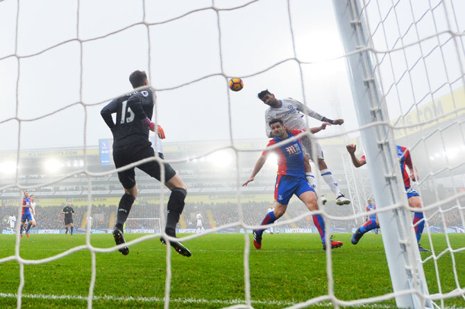 Chelsea's Diego Costa (right) heads the goal against Crystal Palace during their Premier League match at Selhurst Park in London on Saturday