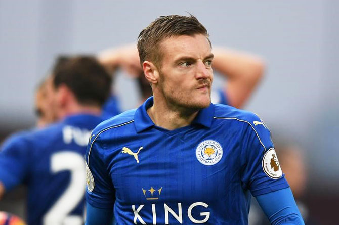 Leicester City's Jamie Vardy walks out after been shown the red card during the match against Stoke City