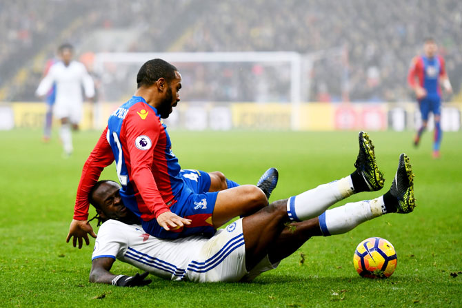 Chelsea's Victor Moses (left) fouls Crystal Palace's Jason Puncheon (right)