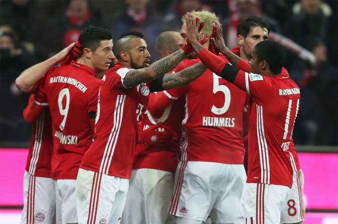 Bayern Munich players celebrate a goal during their Bundesliga match against RB Leipzig at Allianz-Arena in Munich on Wednesday