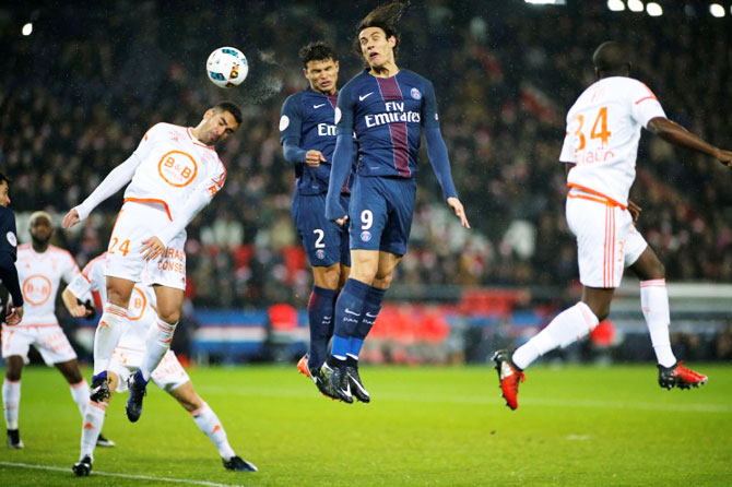 Paris St Germain's Thiago Silva (2) scores their third goal against FC Lorient during their Ligue 1 match in Parc des Princes Stadium on Wednesday
