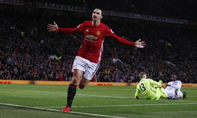 Manchester United's Zlatan Ibrahimovic celebrates scoring their second goal as Sunderland's Jordan Pickford looks dejected