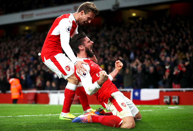 Arsenal's Olivier Giroud celebrates after scoring the opening goal against West Bromwich Albion at Emirates Stadium in London