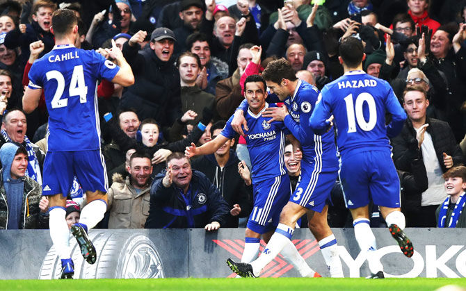 Chelsea's Pedro celebrates with teammates after scoring the first goal against AFC Bournemouth during their English Premier League match at Stamford Bridge in London on Monday