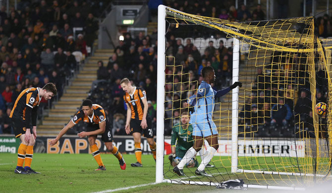 Hull City's Curtis Davies (2nd from left) reacts after scoring an own goal against Manchester City at KCOM Stadium in Hull