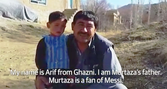 Rediff Sports - Cricket, Indian hockey, Tennis, Football, Chess, Golf - Messi keen to meet Afghan boy in plastic jersey after his pics go viral