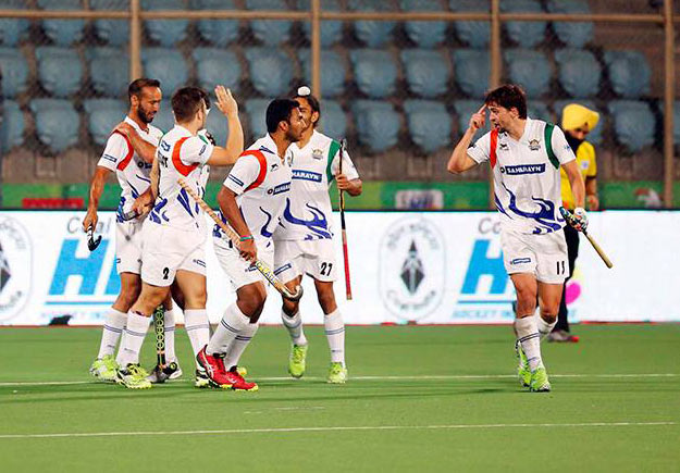 UP Wizards players celebrate their win over Delhi Waveriders in the Hockey India League