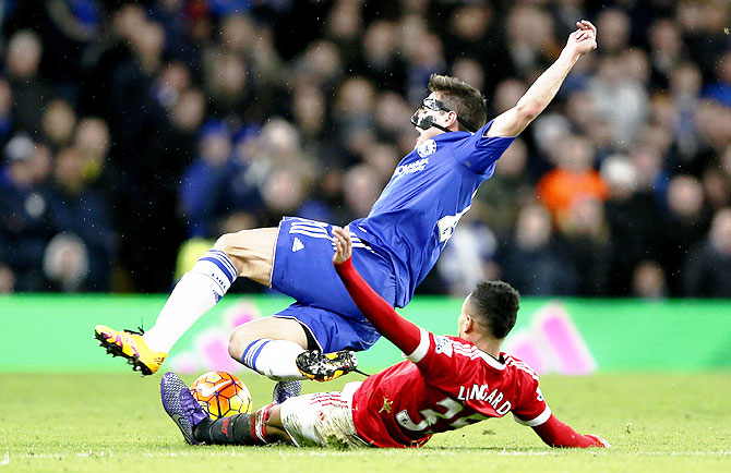 Rediff Sports - Cricket, Indian hockey, Tennis, Football, Chess, Golf - EPL PHOTOS: Late Costa strike helps Chelsea hold Man United