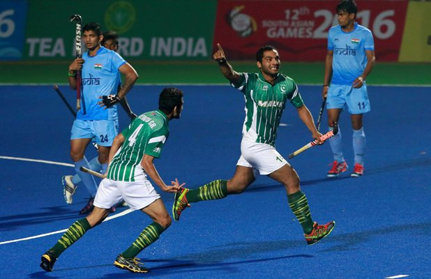 Pakistan's Awais Ur Rehman (second right) celebrates after scoring against India