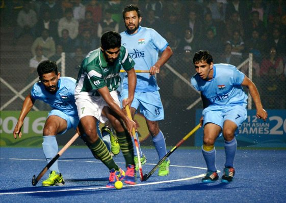 India and Pakistan men's hockey team players in action during 12th South Asian Games in Guwahati