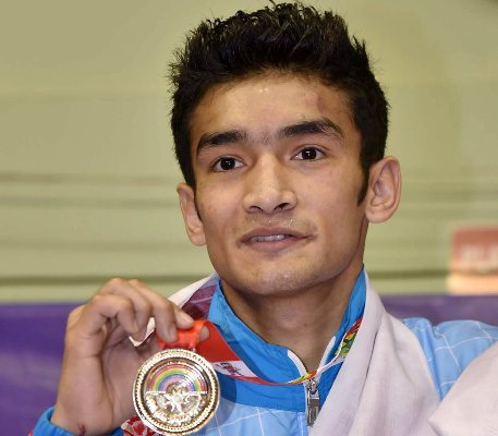 Boxer Shiva Thapa poses for photographs