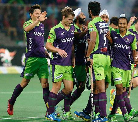 Delhi Waveriders players celebrate a goal
