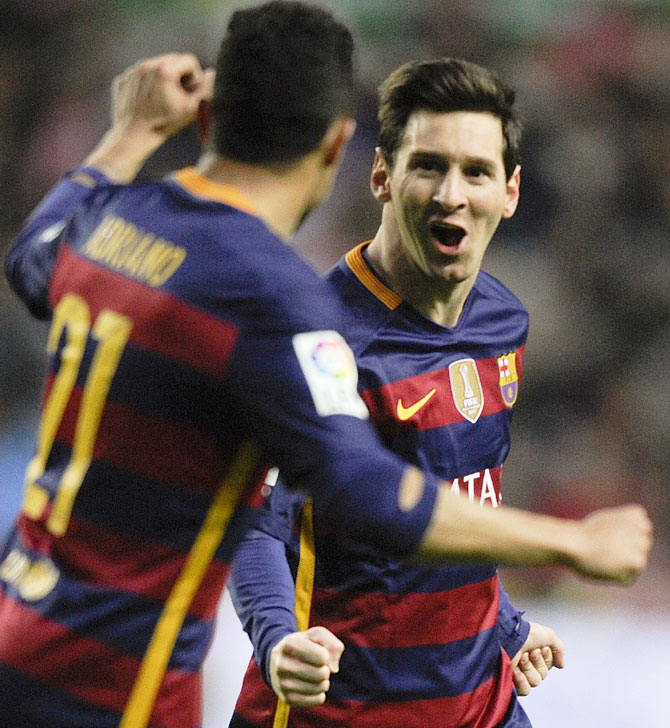 Barcelona s Lionel Messi celebrates with teammate Adriano after scoring a  goal against Sporting Gijon at the 5a4146dd4f1ff