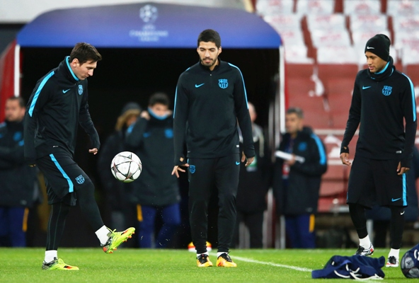 Lionel Messi (left) is watched by team mates Luis Suarez (centre) and Neymar