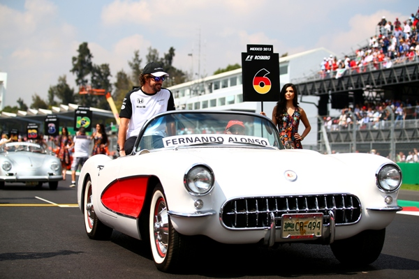 Fernando Alonso of Spain takes part in the drivers' parade in Mexico City