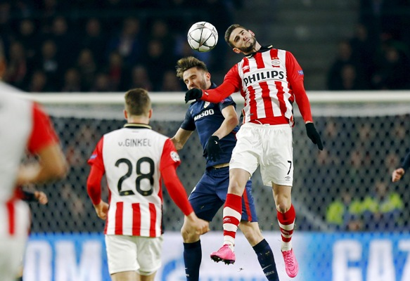 Atletico Madrid's Juanfran in action against PSV Eindhoven's Jurgen Locadia