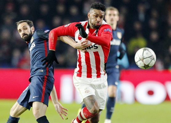 PSV Eindhoven's Gaston Pereiro in action against Atletico Madrid's Saul Niguez