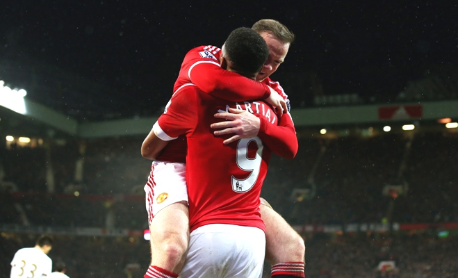 Wayne Rooney of Manchester United celebrates scoring his team's second goal during their Premier League match against Swansea City at Old Trafford