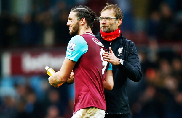 Jurgen Klopp, manager of Liverpool, congratulates Andy Carroll of West Ham United after their Premier League match