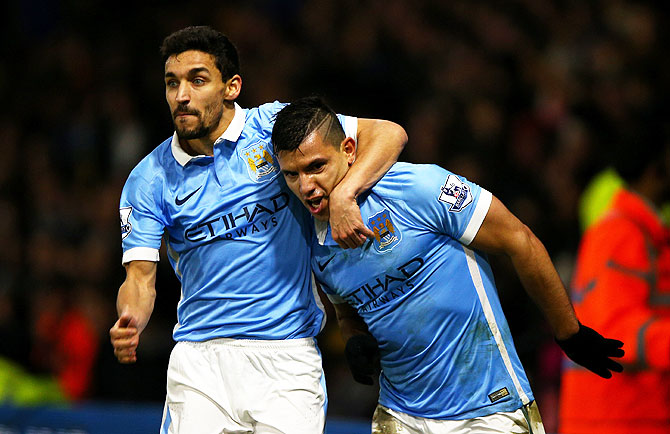 Manchester City'S Sergio Aguero (right) celebrates with teammate Jesus Navas after scoring his side's second goal against Watford at Vicarage Road in Watford