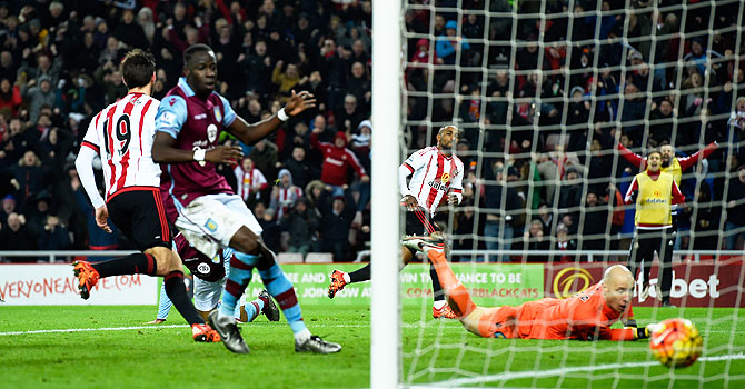 Sunderland striker Jermaine Defoe wheels away after scoring the second goal against Aston Villa at Stadium of Light in Sunderland