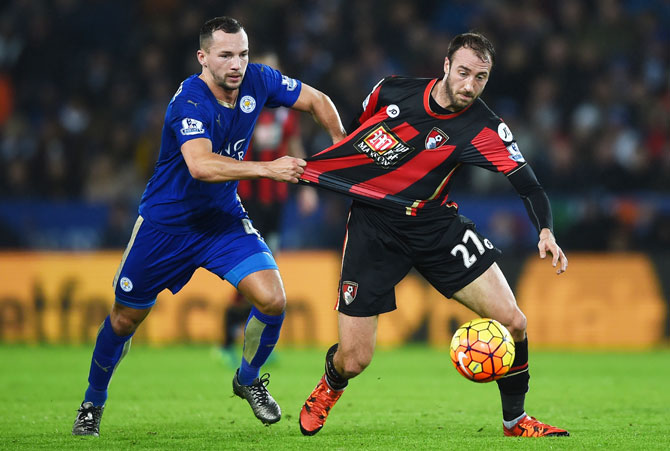 Bournemouth's Glenn Murray and Leicester City's Danny Drinkwater compete for the ball during their match at The King Power Stadium in Leicester