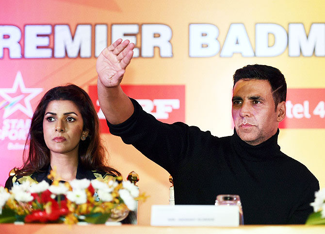 Bollywood actor Akshay Kumar and Nirmit Kaur watch the Premier Badminton League match in Lucknow on Monday