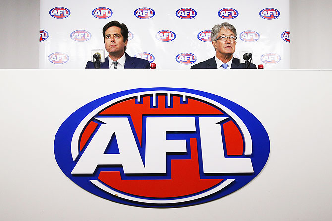 AFL Commission Chairman Mike Fitzpatrick (right) and AFL CEO Gillon McLachlan speak to media, in Melbourne, after bans were issued to 34 Aussie Rules footballers on Tuesday
