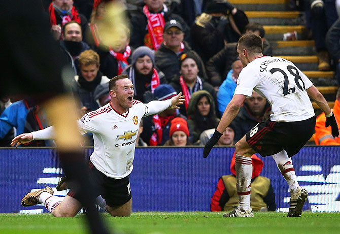 Manchester United's Wayne Rooney celebrates with Morgan Schneiderlin after scoring the winning goal against Liverpool at Anfield on Sunday
