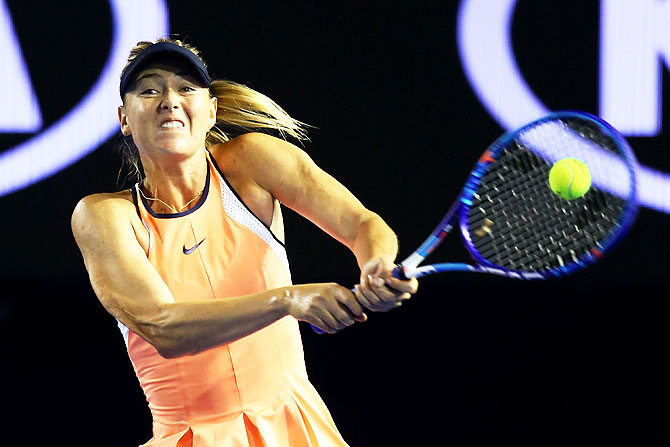Russia's Maria Sharapova plays a backhand in her second round match against Belarus's Aliaksandra Sasnovich at the 2016 Australian Open at Melbourne Park on Wednesday