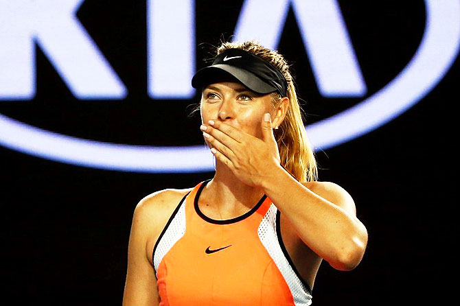 Russia's Maria Sharapova celebrates after winning her second round match against Belarus' Aliaksandra Sasnovich