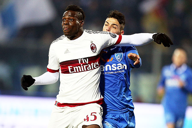 AC Milan's Mario Balotelli in action against an Empoli FC player during their Serie A match at Stadio Carlo Castellani in Empoli on Saturday