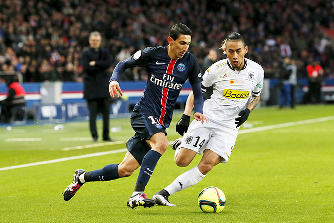 Paris St Germain's Angel Di Maria challenges Angers' Billy Ketkeophomphone as they vie for possession during their Ligue 1 match at the Parc des Princes stadium in Paris on Saturday