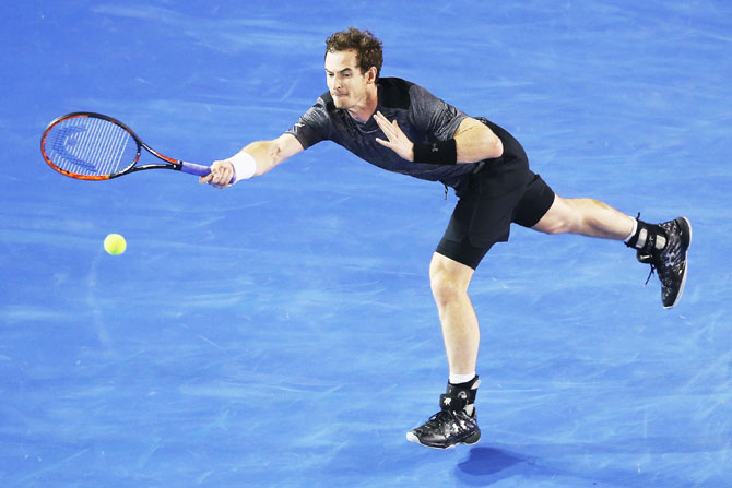 Great Britain's Andy Murray plays a forehand in his fourth round match against Australia's Bernard Tomic
