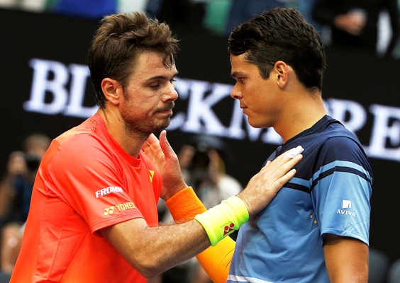 Canada's Milos Raonic (right) and Switzerland's Stan Wawrinka speak at the net